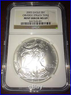 2005 USA $1 Silver Eagle OBVERSE STRUCK THRU MINT ERROR MS 69 NGC Coin