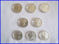8 x 1 oz silver American Eagle 1991 / 1999 / 2005 / 2006 Liberty Dollar in cases